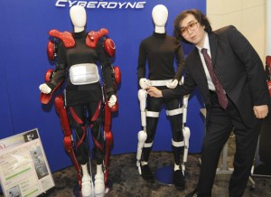 Prof. Sankai posing with different versions of HAL.