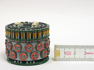 Claytronics is developing tiny computers that can form shapes. Here is their cylindrical protoype.