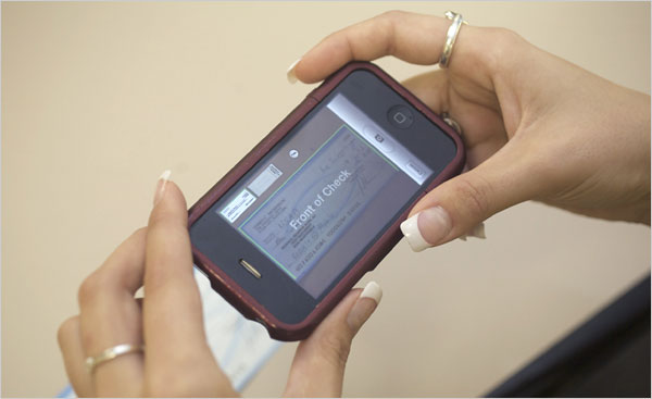 USAA bank allows iPhone users to send in checks via photo.