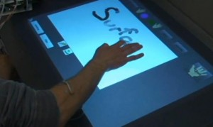 Sensors on the forearm translate muscle movements into control commands for Microsoft Surface.