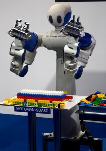 The newest Motoman humanoid robot likes to play with Legos. That's not childish. That's awesome.