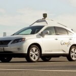 A couple good months for Google: their self-driving Prius tops 300,000 miles and the Lexus RX450h hybrid joins the fleet.