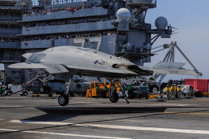 X-47B, Salty Dog 502, autonomously touches down on aircraft carrier.