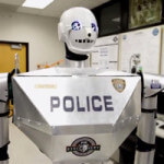 A Telepresence RoboCop Piloted by Oculus Rift and Sensored Gloves