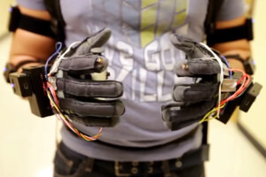 Sensored gloves control the robot's hands.