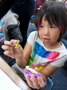 A fourth-grader prototypes her invention as part of the City X Workshop in Eek