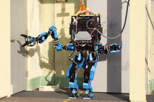Team Schaft's robot opening a door at the 2013 Darpa Robotics Challenge trials.