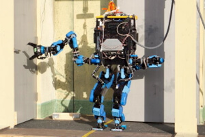 Schaft robot, winner of the DRC trials, opens a door.