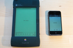 Apple Newton next to a first generation iPhone.