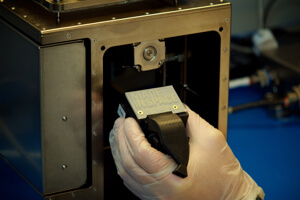 The first 3D printed part in space—a faceplate for the Made in Space 3D printer's printhead.