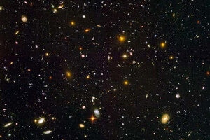 The Hubble Deep Field reveals thousands of galaxies in a tiny patch of featureless sky.