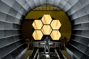 A portion of the James Webb telescope takes shape.