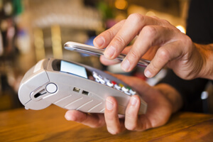 New smartphones use NFC to enable mobile payment.