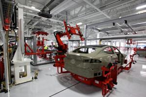 Tesla robotic assembly line.