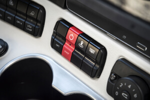 Drivers would push the red button to hand over controls to the truck's 'highway pilot' system.