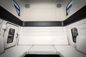 The truck's plush interior includes a wrap around sofa/bed combo.