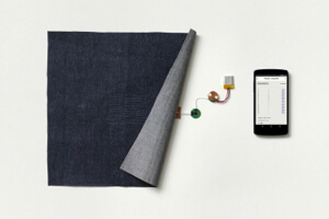 Miniature electronics control a swatch of conductive fabric.