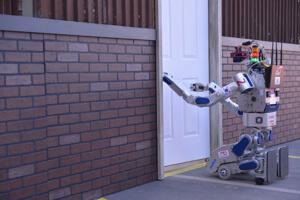 KAIST DRC-Hubo robot turns a door handle.