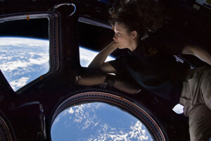 Tracy Caldwell Dyson gazes out the window on the International Space Station.