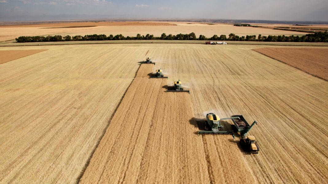 harvesters-combing-on-prairie-landscape