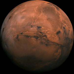 Mars bisected by the Valles Marineris canyon.
