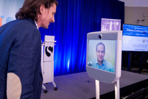 Singularity University CEO Rob Nail speaks with a remote presenter following their Impact Challenge pitch.