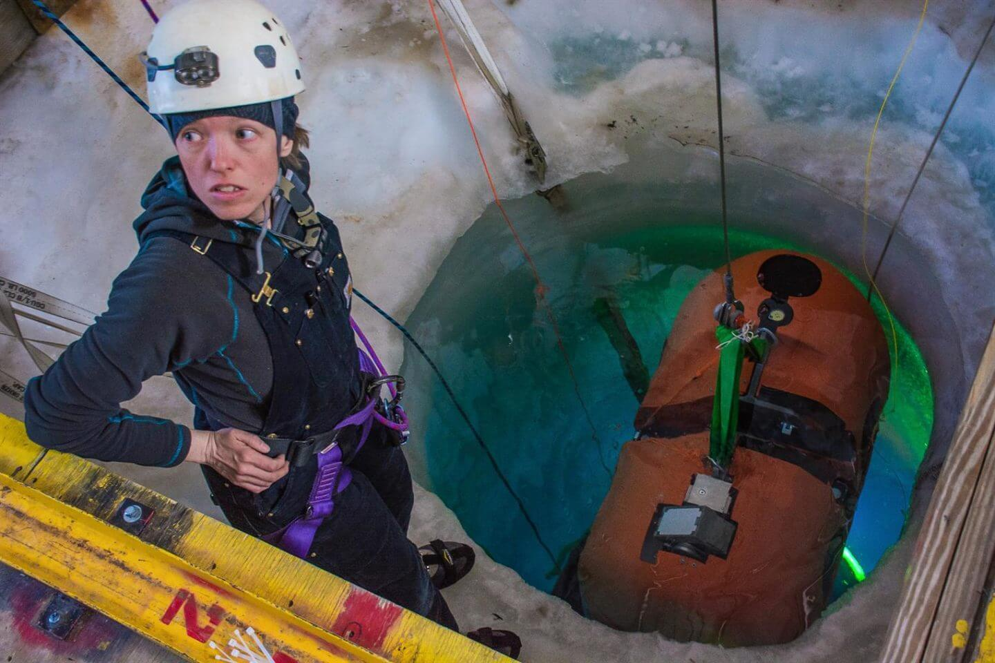 Vickie Siegel looks up from the hole drilled in the sea ice as the underwater autonomous vehicle ARTEMIS is lowered into the water below. The Sub-ice Investigation of Marine and Planetary-analog Ecosystems (SIMPLE) project is funded by NASA, and is the basis for the technology that will one day be used to investigate the icy ocean on Jupiter's moon Europa. The project's lead scientist is Britney Schmidt from the Georgia Institute of Technology. Photographed by: Mike Lucibella, ASC