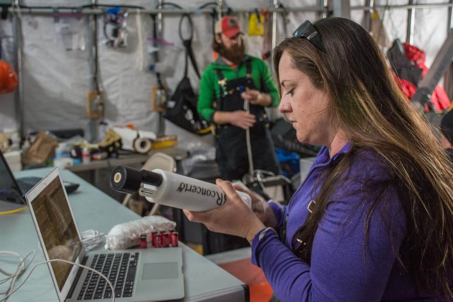 Britney Schmidt, the lead scientist for the project SIMPLE, readies a CTD, which measures the conductivity, temperature, and depth of the seawater. This is to corroborate readings from the underwater autonomous vehicle ARTEMIS. The Sub-ice Investigation of Marine and Planetary-analog Ecosystems (SIMPLE) project is funded by NASA, and is the basis for the technology that will one day be used to investigate the icy ocean on Jupiter's moon Europa. The project's lead scientist is Britney Schmidt from the Georgia Institute of Technology. Photographed by: Mike Lucibella, ASC