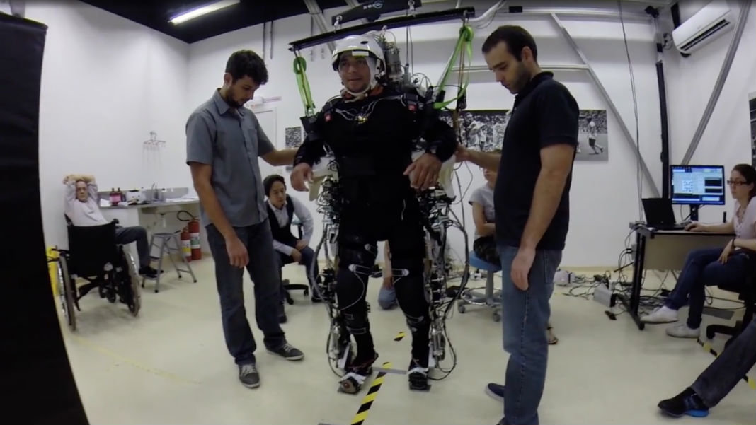 Paralyzed-man-moving-body-mind-controlled-exoskeleton