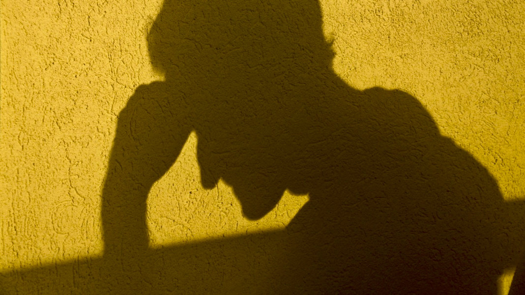 Thinker-shadow-yellow-silhouette