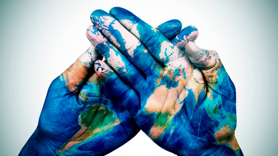 World Map On Hands.Man Hands Patterned With A World Map Furnished By Nasa