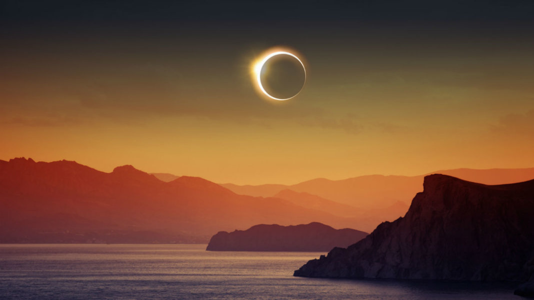 total-solar-eclipse-ocean-sunset-reality
