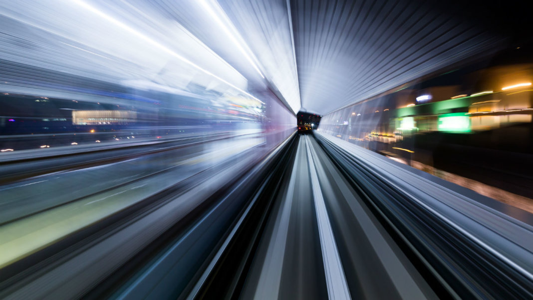 technology-evolving-light-trail-accelerating-through-tunnel