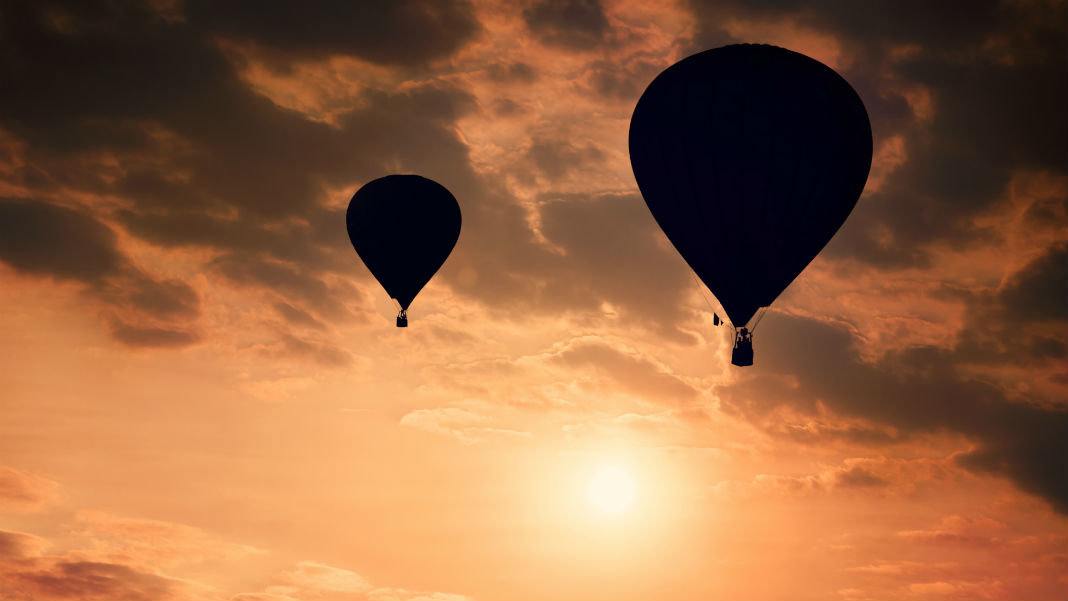awesome-tech-stories-hot-air-balloons-silhouette-against-sunny