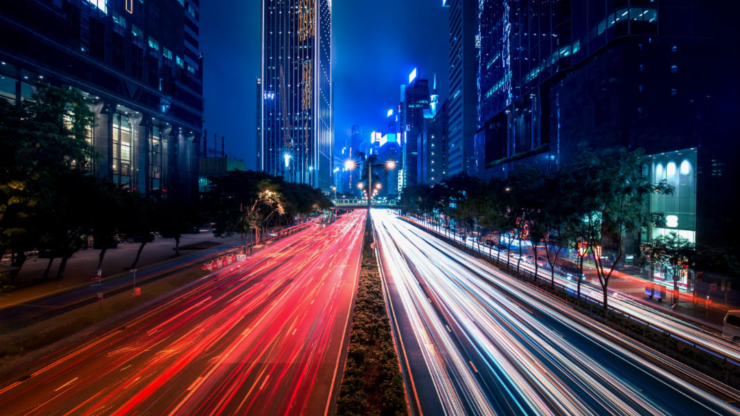 autonomous-vehicles-cars-blurred-hong-kong-city-street-view-night