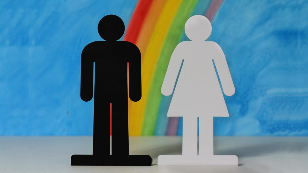 gender icons on rainbow and blue sky background