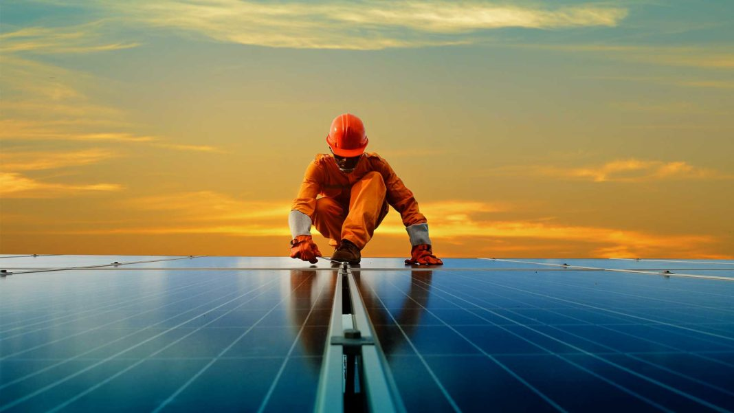 man working at solar power station