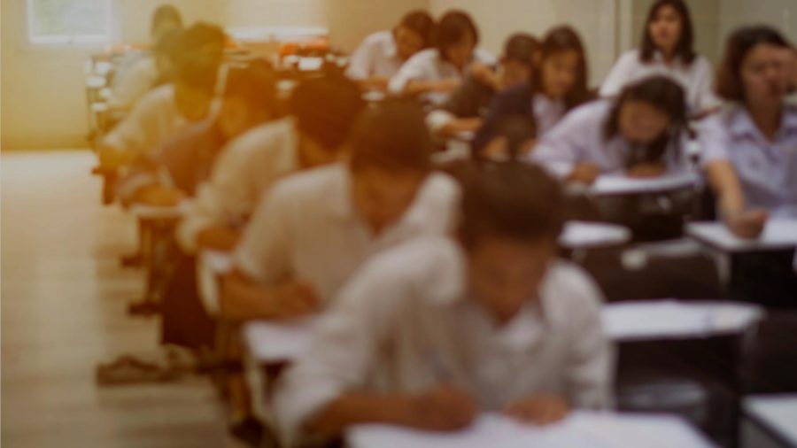 students in exam room blurred