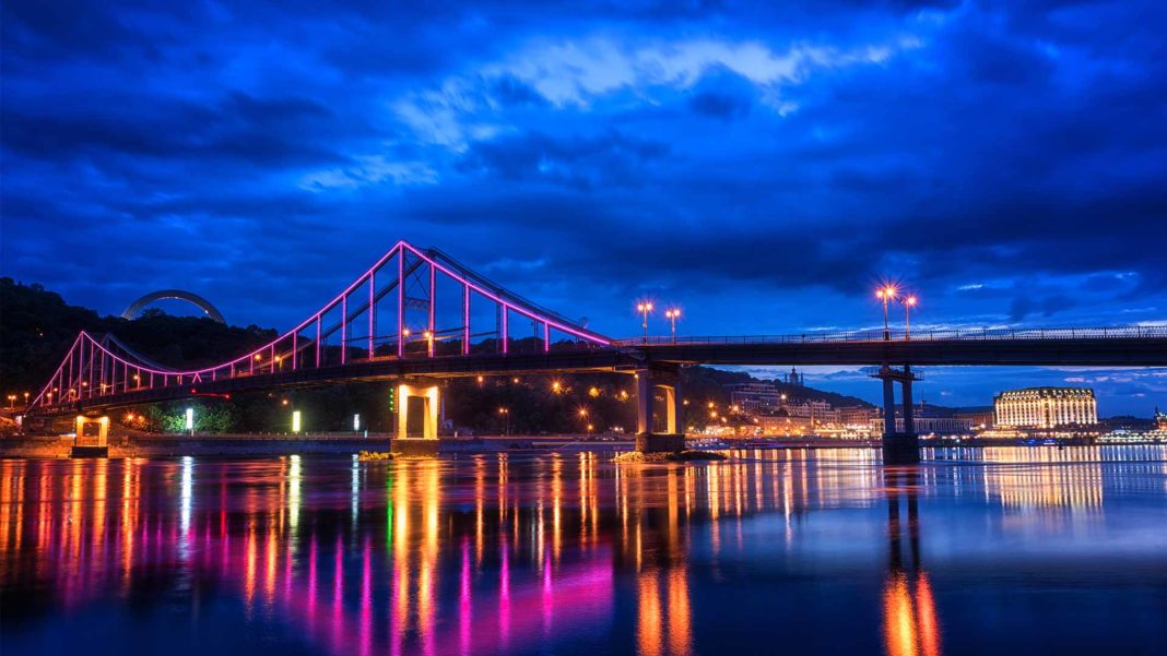 City in Ukraine bridge with colorful lights at night