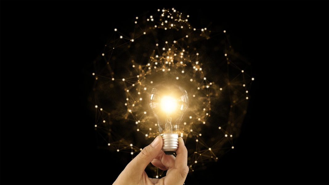 lightbulb with particles innovation future technology