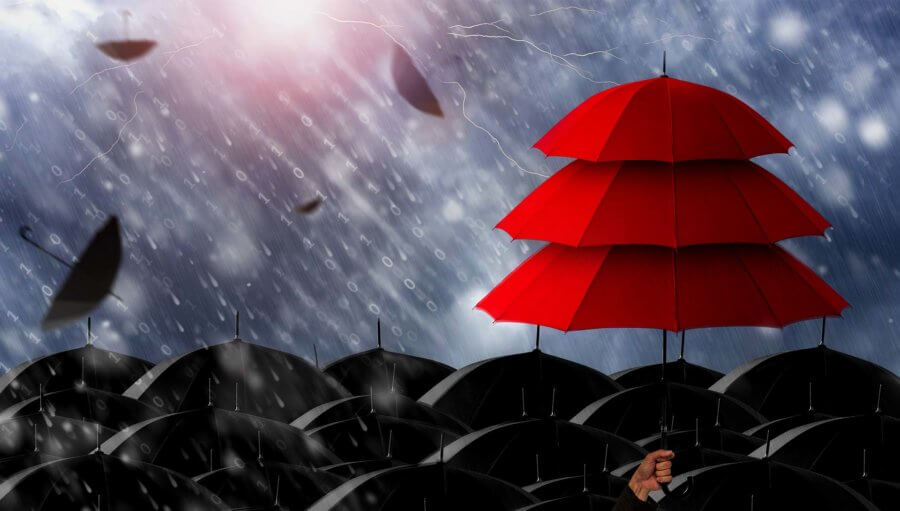 insurance agent holding three layer red umbrella
