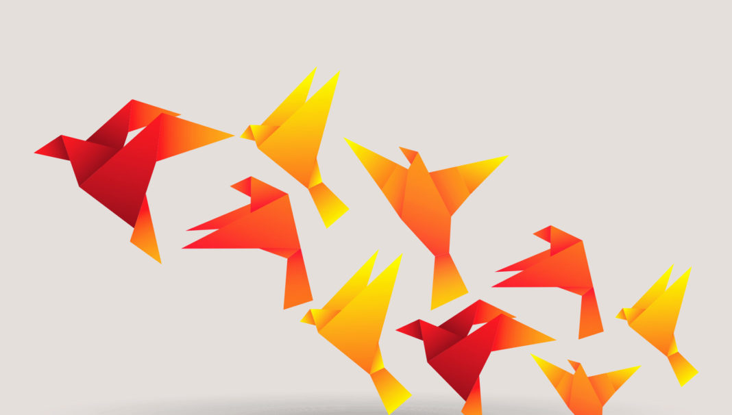 orange origami birds flying