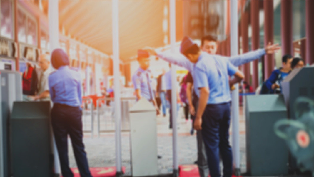 blurred airport security check gates