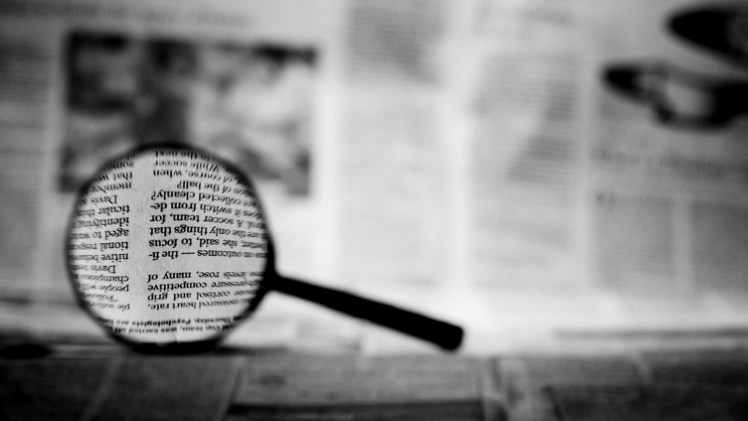 magnifying glass newspaper