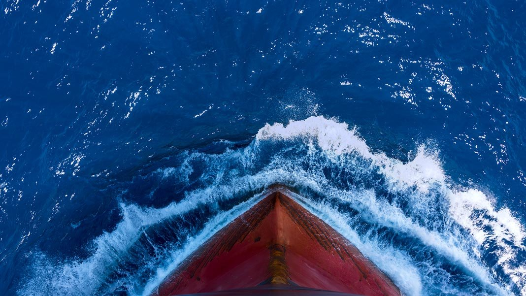 ship moving through ocean waves