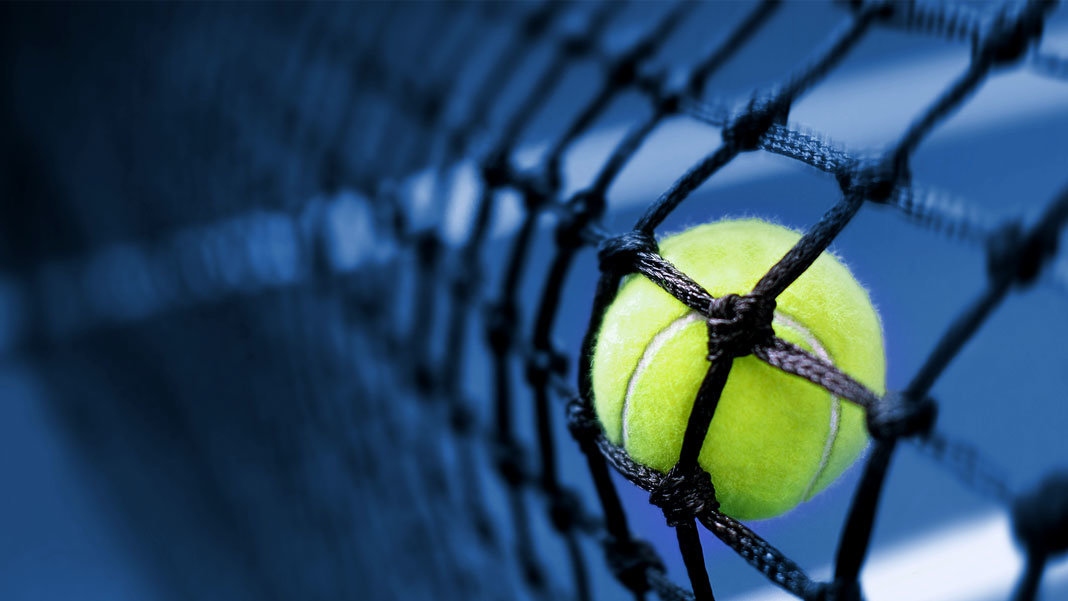 tennis ball on court net