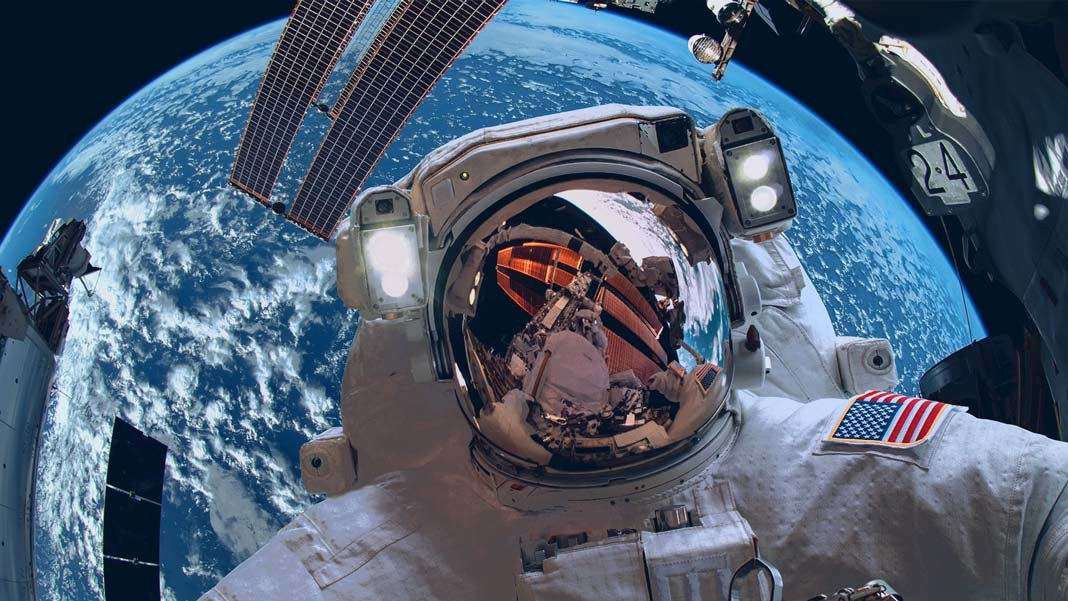 International Space Station and astronaut in outer space