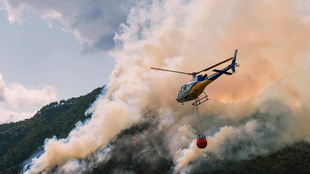 aerial firefighting with helicopter in mountains disaster relief - Convergence Peter Diamandis