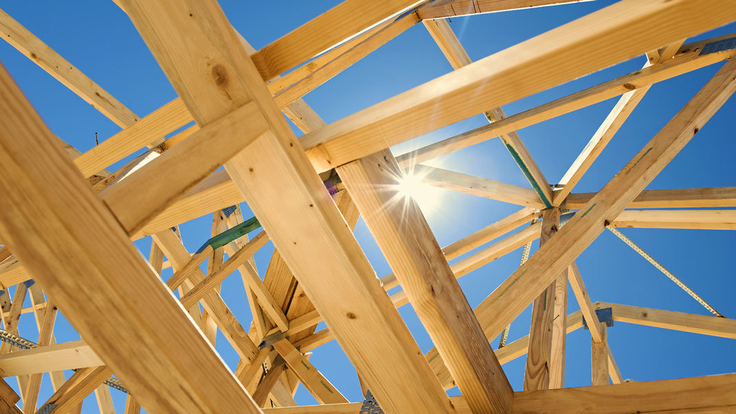 home framing with blue sky and sun background future of energy