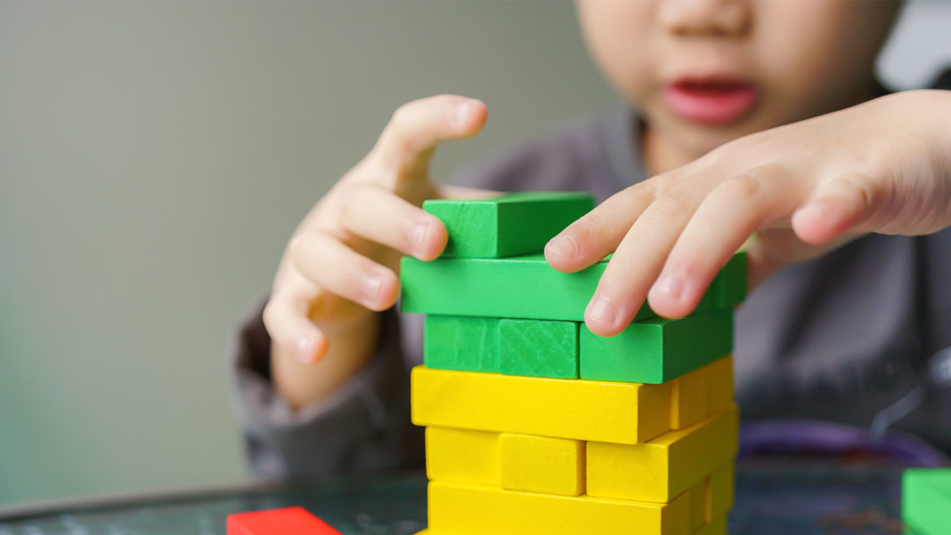 asian child playing with colorful blocks artificial intelligence